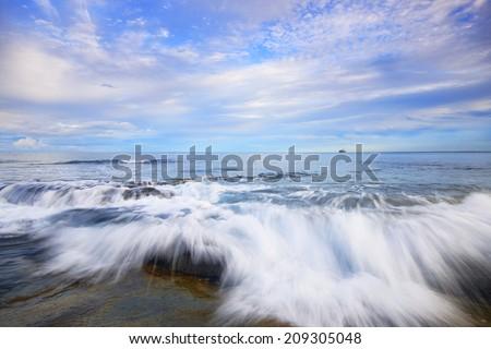 Rocks and waves at Kings Beach - Sunshine Coast, QLD. stock photo