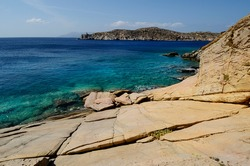 Rocks carved by the sea at Valmas beach on the west coast of the Greek island of Ios in the Cyclades archipelago