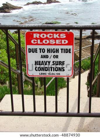 rocks closed sign on beach