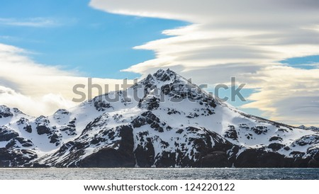 Rocks covered with snow in South Georgia, British overseas territory, Southern Atlantic Ocean.