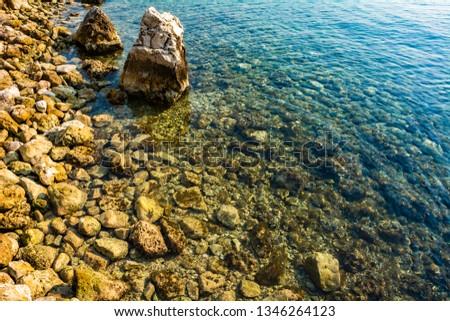 Rocks in sea ocean shallow water calm - Sea ocean rock waterline underwater - Calm sea ocean rock under golden sun wild coast #1346264123