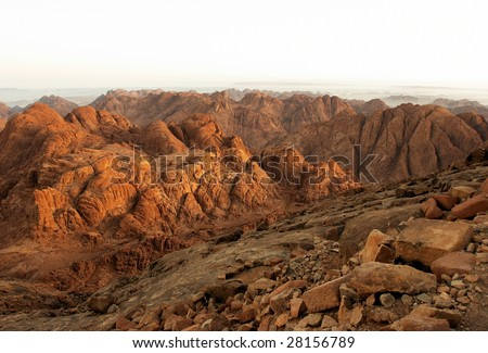 "Rocks of holy ground Mount Sinai in early morning.  ""And the mountains shall be molten under him, and the valleys shall be cleft, as wax before the fire..."" Micah 1:4"