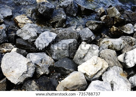 rocks of sea and river, beach with water and sand #735788737