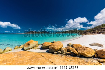 Rocks on the amazing Whitehaven Beach with white sand in the Whitsunday Islands, Queensland, Australia #1145185136