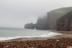 Rocks on the coast of the Japanese sea in the fog. Dubovaya Bay, Primorsky Krai, Far East