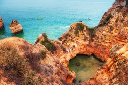 Rocks on the shore of Atlantic ocean in Algarve, Portugal. Beautiful summer seascape, famous travel destination