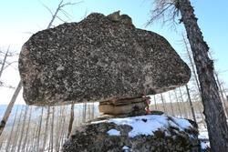 Rocks. Rock balance. A large stone lies on a small one and does not fall. Russia, Burytia, Bount District, village Karaftite.