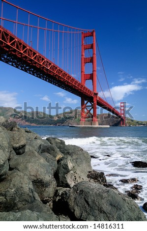 Rocks under Golden Gate Bridge. Shot from Fort Point, San Francisco.