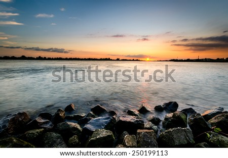 rocks, water and sky at sunset with rule of third #250199113