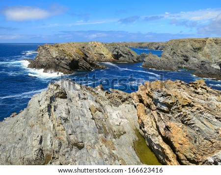 Rocks with caves at the coast of Brittany, France #166623416