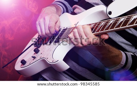 rockstar playing solo on guitar