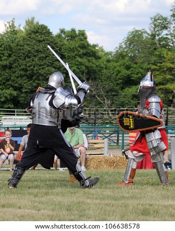 ROCKTON FAIRGROUNDS - JUNE 23:  The combat of two knights at Tresureventure in June 23 2012 in Rockton, Canada.