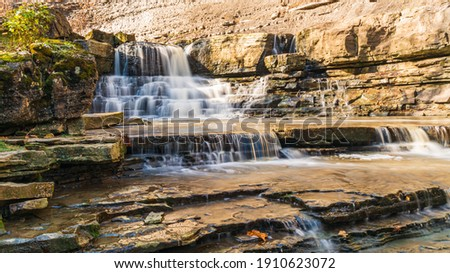 Rockway Falls Conservation Area Lincoln Ontario Canada in late autumn showing cascades along Sixteen Mile Creek on a cold sunny day  Stock photo ©