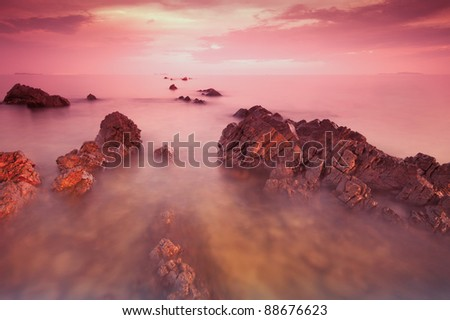 rocky beach at sunset.