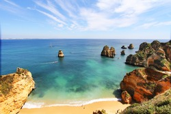 Rocky beach at sunset, Lagos, Portugal. Travel and business background
