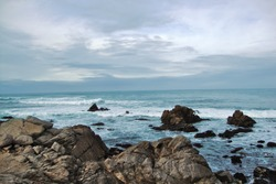 Rocky beach on a cloudy day. rocky seashore. shoreline