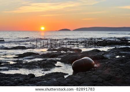 Rocky beach sunset.