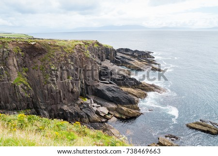 Rocky cliffs along Wild Atlantic Way dramatic and scenic tourist route on Irish west coast #738469663