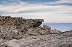 Rocky Cliffs at Mediterranean sea coast. Vintade filter effect