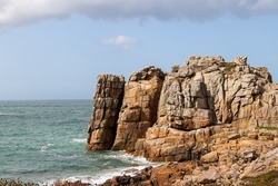 Rocky cliffs on the Pink Granite Coast - Cote de Granit Rose - near Le Gouffre in Brittany, Cotes d´Armor, France