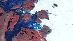 Rocky coast and glacier, snow and ice float on the surface of the sea. Northern region. contains modified Copernicus Sentinel data