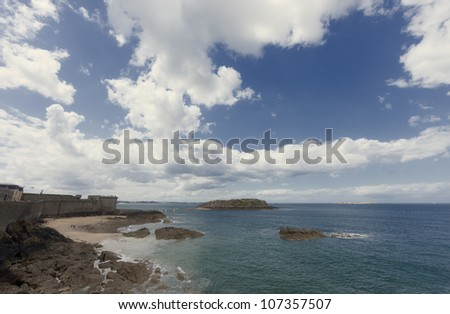 Rocky coast and town wall in Saint-Malo - Saint-Malo, Brittany, France