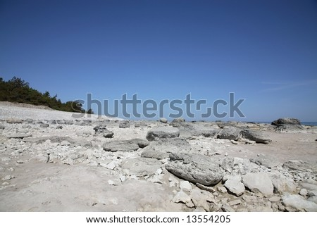 Rocky coast at low tide at the uttermost point of the Swedish island Faaroe near Gotland