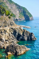 Rocky coast near Riomaggiore with part of the Love Road (Via dell'Amore) in Cinque Terre National Park, Italy