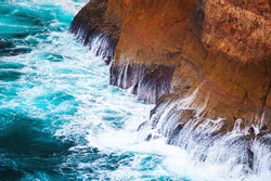Rocky coast of Atlantic ocean in Cape St. Vincent, Algarve, Portugal. Close up view of waves and cliffs