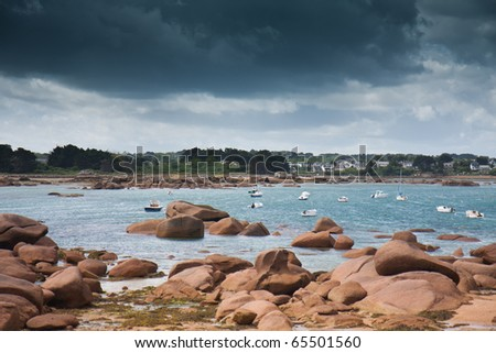 Rocky coast of Brittany in France with threatening thunderstorm
