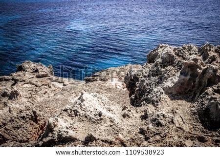 Rocky coast of mallorca with sea #1109538923