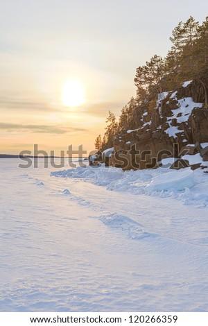 Rocky coast of the frozen winter sea. Barents sea.