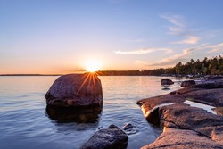 Rocky coast of the gulf of finland at sunset. Summer in Finland