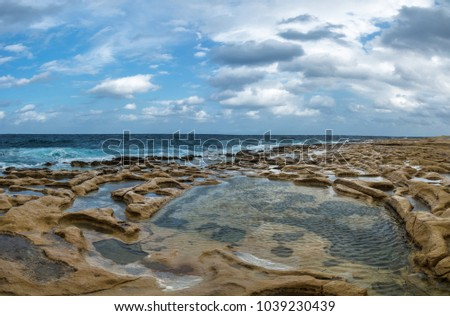 Rocky coast with lagoons in Valletta, Malta. #1039230439