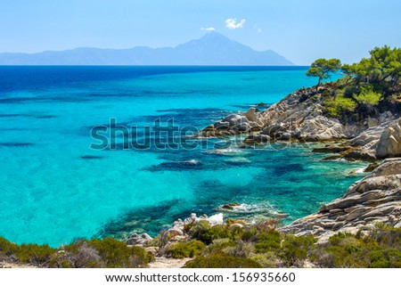 Rocky coastline and a beautiful clear water at Halkidiki Kassandra peninsula in Greece