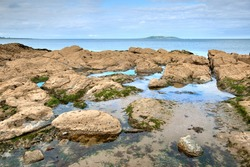 Rocky coastline and view over Irish Sea in Malahide, County Dublin, Ireland
