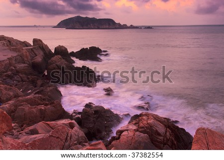 Rocky coastline before sunrise in the southeast of China