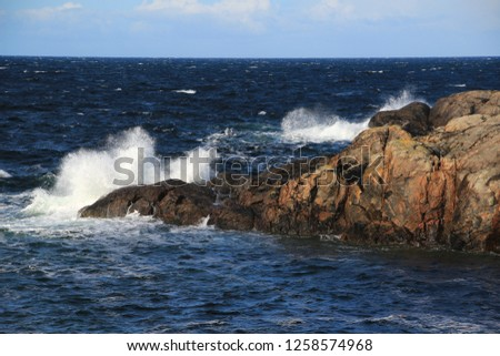 rocky coastline in scotland highlands surf spray #1258574968