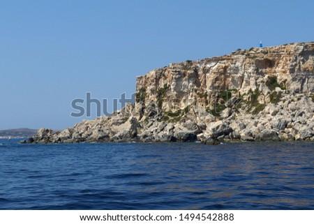 rocky coastline on Malta island with calm blue sea #1494542888