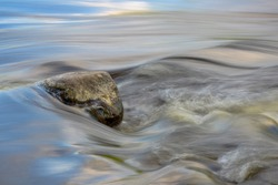 Rocky detail of flowing river