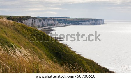 Rocky french coastline in Normandy. High cliffs