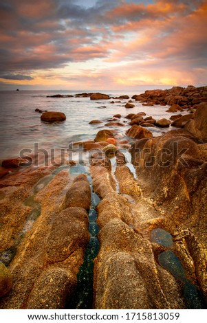 Rocky Galician coast at sunset