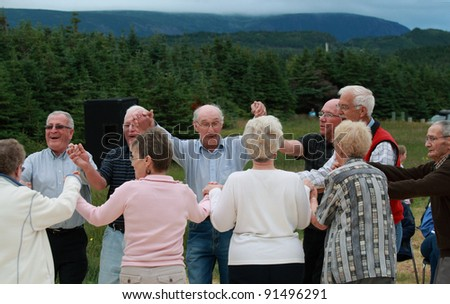 ROCKY HARBOUR, CANADA – JULY 16: Seniors dancing outdoors on July 16, 2011 in Rocky Harbour, Newfoundland. The event was part of Parks Canada's 100th anniversary festivities.