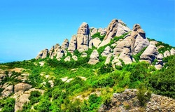 Rocky hill in the mountain. Mountain rock view. Rocks in mountains. Mountain hill rock