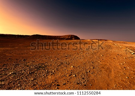Rocky hills of the Negev desert in Israel at sunset. Wind carved rock formations in the Southern Israel Desert. #1112550284