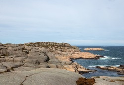 Rocky landscape and coastline with waves hitting the cliffs in Sweden