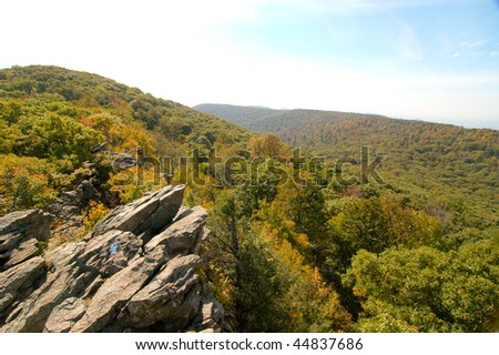 rocky mountain peak and view of an autumn valley