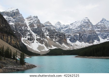 Rocky mountain peaks and moraine lake in spring, banff national park, alberta, canada
