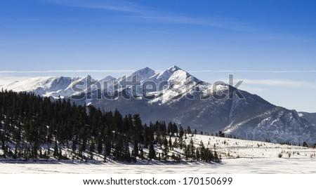 rocky mountain peaks in winter
