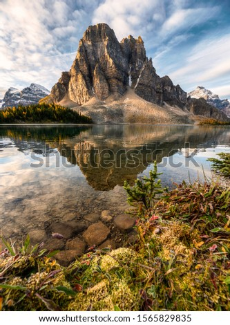 Rocky mountain reflection on Cerulean lake in Assiniboine provincial park, Canada #1565829835